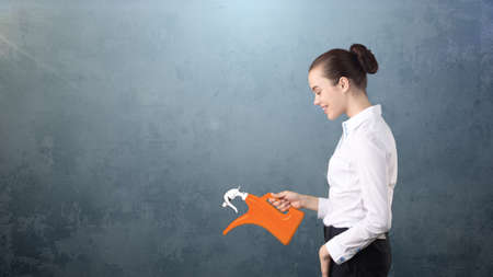 Beauty business woman watering invisible plant presenting investment and financial growth concept. Isolated background