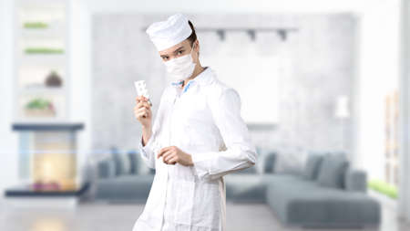 Beautiful medical woman doctor in uniform. Studio painted background. Concept of profitable health care and business. Stock Photo