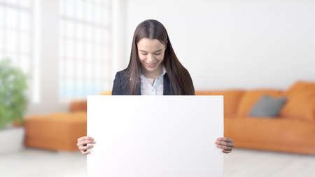 Young Business woman over interior background Stock Photo