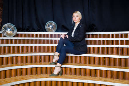 Beautiful blonde businesswoman with puffy lips at loft office in suit. Business concept.