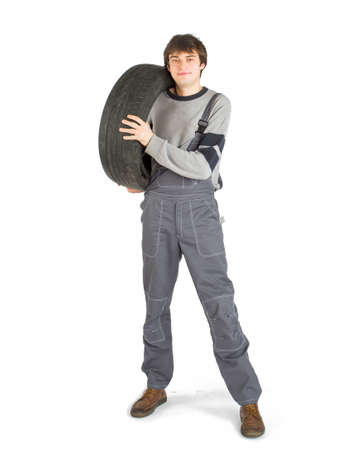 A young brunet foreman in working grey uniform with black wheel. Foto de archivo