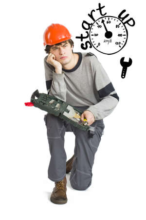 Business concept of self-made man. Young laborer man in orange helmet over white background with sketches. Stock Photo