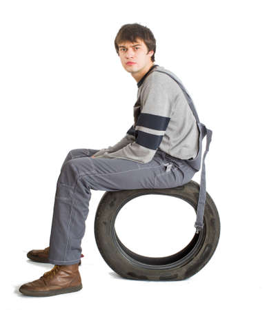 A young brunet foreman in working grey uniform with black wheel. Stock Photo