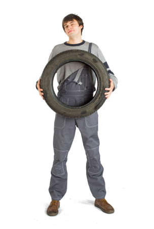 A young brunet foreman in working grey uniform with black wheel. 版權商用圖片