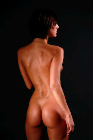 nude butt: sexy backside of a young brunette woman Stock Photo