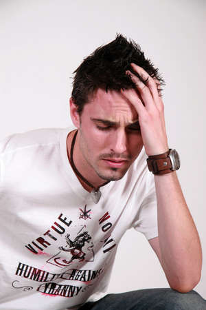 pressured: male with his head in his hands, very depressed or with a headache