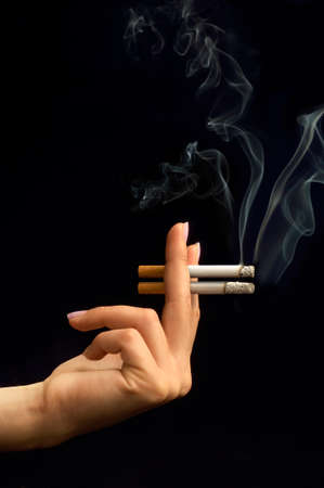 Female Hand Smoking Cigarette Couple with Ash on Black Background