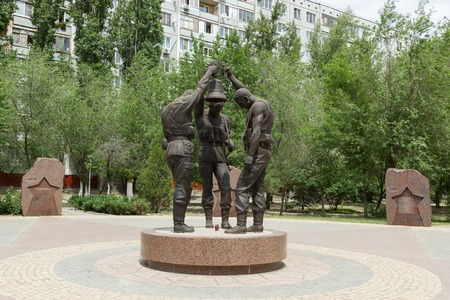 ak 74: Monument to Soldiers of the USSR fought in Afghanistan on the background of the granite memorial slabs, died voenoslujashim in the performance of international debt in Afghanistan, located in Traktorozavodsky area, in the Park of Memory, Volgograd, Russi Editorial