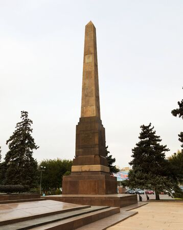 VOLGOGRAD, RUSSIA - October 20, 2015: The obelisk is devoted to the Proletariat of Red Tsaritsyno to the fighters for freedom tortured by White Guard army in 1919, placed into the square of the Fallen fighters. Volgograd, Russia