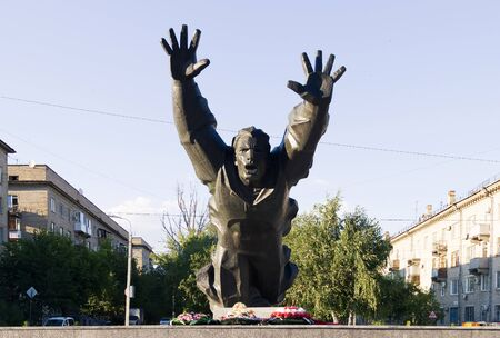 VOLGOGRAD, RUSSIA - July 02, 2015: The monument to the Soviet hero, soldier of World War II Mikhail Panikakhe, is established in krasnooktyabrsky the area, Metallurgov Avenue, Volgograd, Russia Editorial