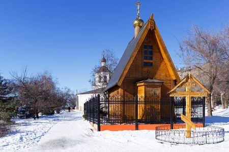 VOLGOGRAD, RUSSIA - February 13, 2015: a Wooden house near the Church of St. John the Baptist. Volgograd, Russia Editorial