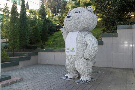 olympic games: SOCHI, RUSSIA - November 06, 2015: The big Polar bear in a scarf has raised a paw - a symbol of the Olympic Games 2014 in the city of Sochi. Sochi, Russia Editorial