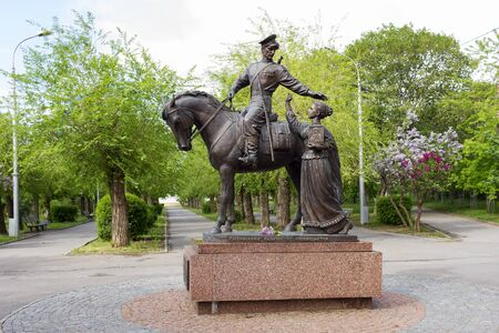 VOLGOGRAD, RUSSIA - May 3, 2016: A monument the Cossack glory - the girl with an icon sees off the guy on a horse at way. It is established on the central embankment. Volgograd, Russia