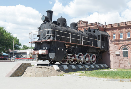 yup: TAGANROG, RUSSIA - June 24, 2016: A monument the Old engine of the YuP 4504 series at Vozrozhdeniya Square in the city of Taganrog, Russia Editorial