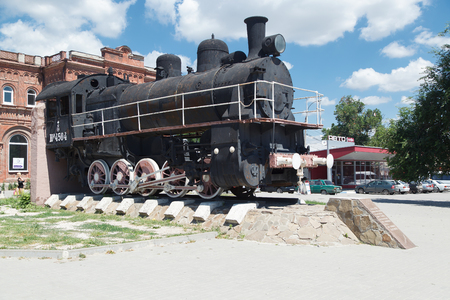 TAGANROG, RUSSIA - June 24, 2016: A monument the Old engine of the YuP 4504 series at Vozrozhdeniya Square in the city of Taganrog, Russia Editorial
