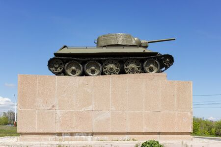 VOLGOGRAD, RUSSIA - May 04, 2016: A monument the Chelyabinsk collective farmer, the T-34 tank in a profile, against the blue sky. Zemlyachki Street, Volgograd, Russia