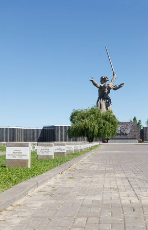 VOLGOGRAD, RUSSIA - July 06, 2016: The soldiers cemetery, mass graves and a sculpture the Motherland calls! Museum panorama Mamayev Kurgan, Volgograd, Russia Editorial