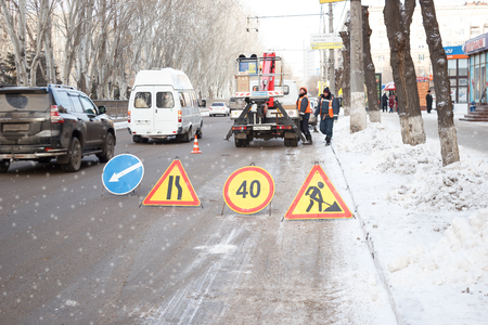 VOLGOGRAD, RUSSIA - December 15, 2016: Temporary road signs stand on the highway in the winter for carrying out a roadwork Редакционное