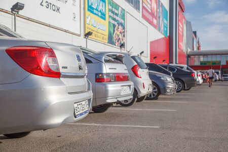 VOLGOGRAD, RUSSIA - August 05, 2016: The parked cars before the shopping center Diamond, traktorozavodsky the area. Volgograd, Russia Editorial