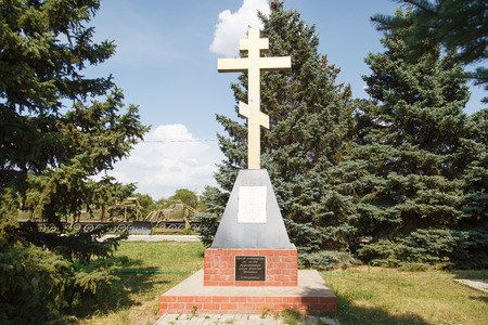 VOLZHSKY, RUSSIA - July 30, 2016: A religious cross, on the avenue of memory to the children of the military of Stalingrad who have died in days of the Great Patriotic War