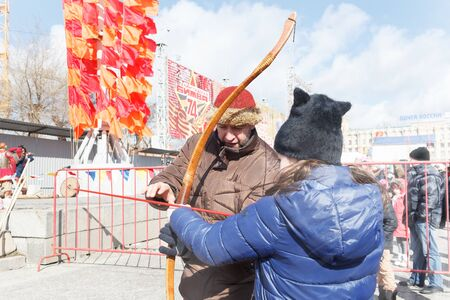 VOLGOGRAD, RUSSIA - February 26, 2017: Maslenitsa holiday, festivities and entertainments on the area of the fallen Fighters