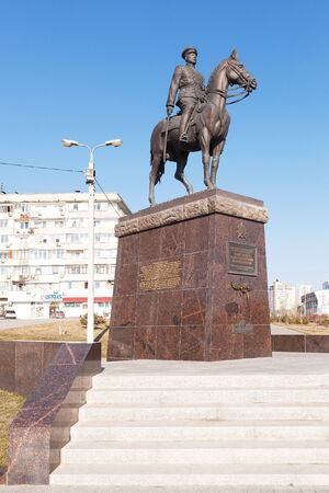 VOLGOGRAD, RUSSIA - April 02, 2017: A monument Rokossovskomu Konstantin Konstantinovichu sitting on a horse also holds a saber in hand against the background of the blue sky