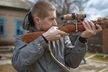 The modern man looks in a sight of a rifle of World War II, Mosins rifle