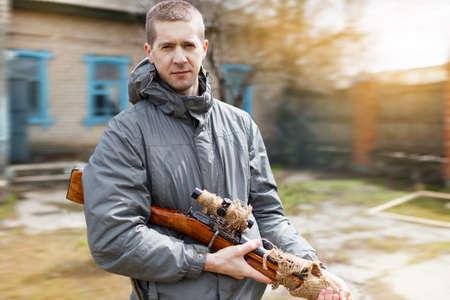 The modern man looks in a sight of a rifle of World War II, Mosins rifle. Stock Photo