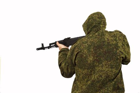 The man with a hood keeps in a military green jacket about AK-74 Kalashnikov on a white background, a close up