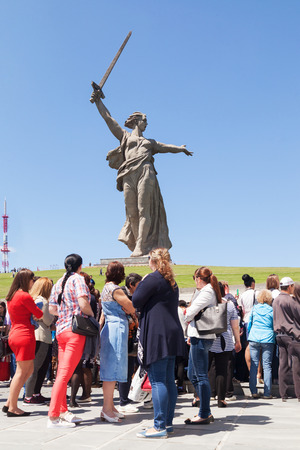 VOLGOGRAD, RUSSIA - May 28, 2017: Tourists, there are a lot of people against the background of a monument to the Great Patriotic War, World War II, the Motherland calls!, in the territory Mamayev Kurgan, Volgograd, in the summer in the afternoon