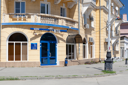 TAGANROG, RUSSIA - June 25, 2017: A blue entrance door to the old brick building with an inscription VTB Bank outside, the city of Taganrog in the summer Editorial