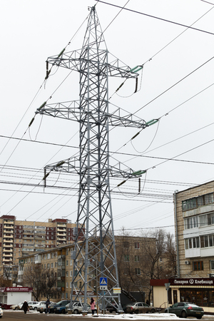 VOLGOGRAD, RUSSIA - January 26, 2018: The high-voltage metal support of a power line, is established about houses