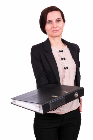 The business woman the brunette in a jacket stretches the folder with documents, on the isolated white background forward. A portrait on a belt