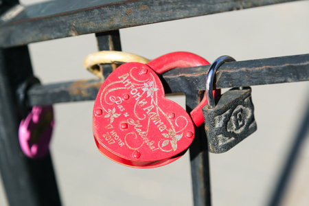 VOLGOGRAD, RUSSIA - April 11, 2018: The freezing-up lock with a love inscription for memory