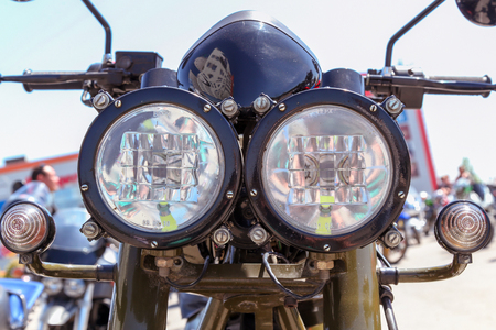 VOLGOGRAD, RUSSIA - May 5, 2018: Motorcycle headlights. Close up