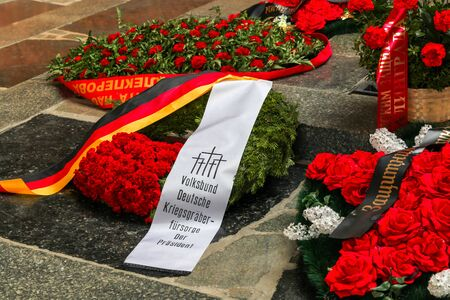 VOLGOGRAD, RUSSIA - May 9, 2018: A wreath on a grave to the soldiers who have died �овет�км with the German, German flag and an inscription on a stone