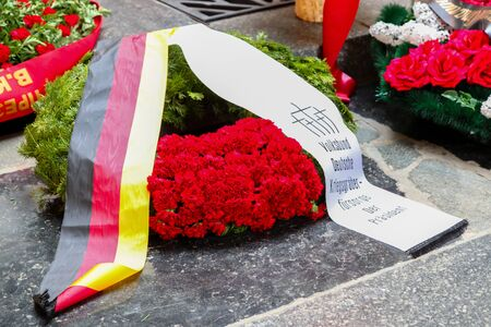 VOLGOGRAD, RUSSIA - May 9, 2018: A wreath on a grave to the soldiers who have died советскм with the German, German flag and an inscription on a stone Editorial