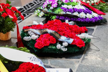 VOLGOGRAD, RUSSIA - May 9, 2018: A wreath from flowers on a grave to the soldiers who have died �овет�км on a gray granite stone