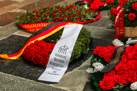 VOLGOGRAD, RUSSIA - May 9, 2018: A wreath on a grave to the soldiers who have died советскм with the German, German flag and an inscription on a stone