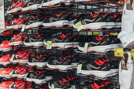 Running sneakers are on sale on the shelf of shop