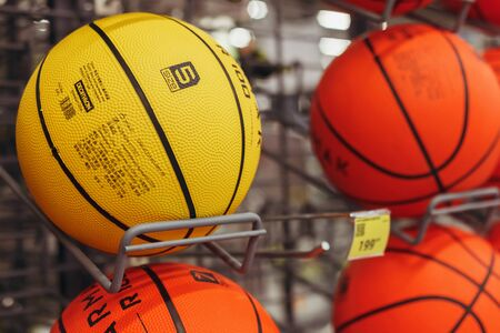 Basketballs are on sale on the shelf in the shop