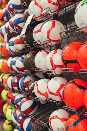 Regiments with sports stock, multi-colored soccerballs are on sa