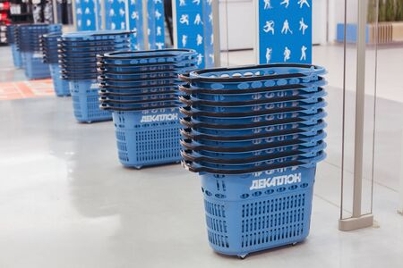 Consumer baskets in shop stand in a row