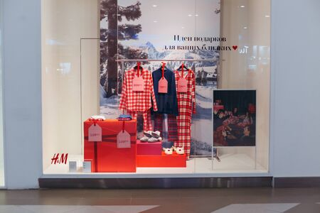 Show-window of H&M shop in the shopping center Watercolor, Volgo