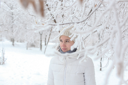 The girl in the park in the winter among snow