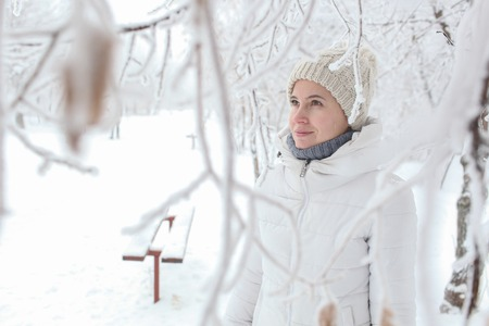 The girl is in the park in the snow winter
