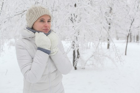 The girl walks in the park in the winter. A portrait on a belt