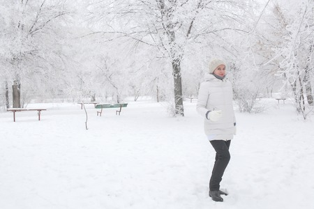 The girl walks in the park in the winter. Portrait to the utmost