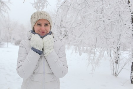 The girl walks in the park in the winter among snow. A portrait on a belt Stok Fotoğraf