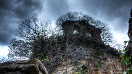 An old abandoned hermitage with a frightening look Banco de Imagens
